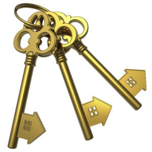 Real estate concept: bunch of golden house-shape keys isolated on white background